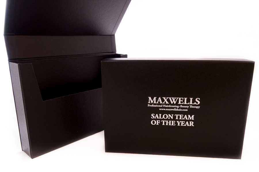 Black cloth over board box folder to take A4 documents with silver foil blocked lettering
